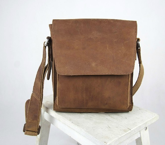 The Messenger Bag was inspired by vintage leather army bags from the 's. Handcrafted in the USA of full grain vegetable tanned leather, this bag will age beautifully.