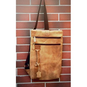 brown leather strap bag