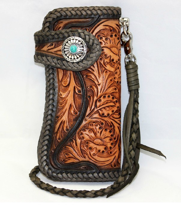 Hand carved leather wallet tooled